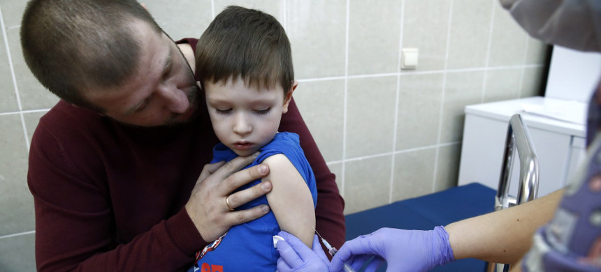 Child is vaccinated in Moscow, Russia. (photo: Artyom Geodakyatass/Getty)