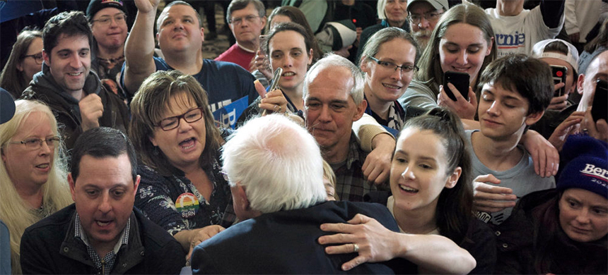 Supporters in Concord, New Hampshire, reach out to greet the man they call Bernie. (photo: Steve Senne/AP)