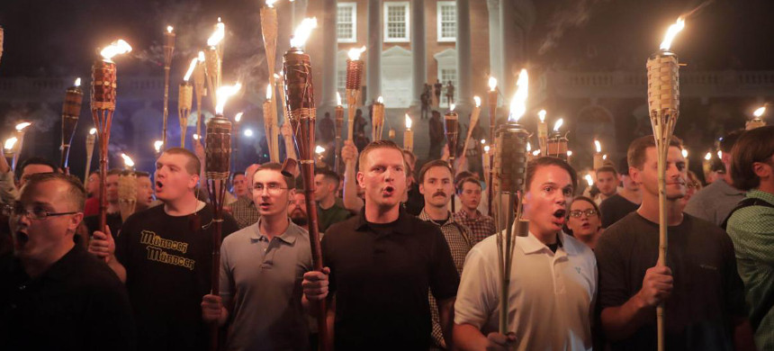 White supremacists led a torch march though the grounds of University of Virginia in Charlottesville, Virginia. (photo: Andrew Shurtleff/The Daily Progress)