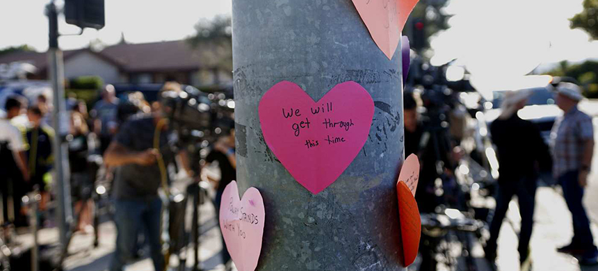 Will we? (An impromptu memorial made by community members across the street from the synagogue on Saturday.) (photo: Sandy Huffaker/AFP/Getty Images)