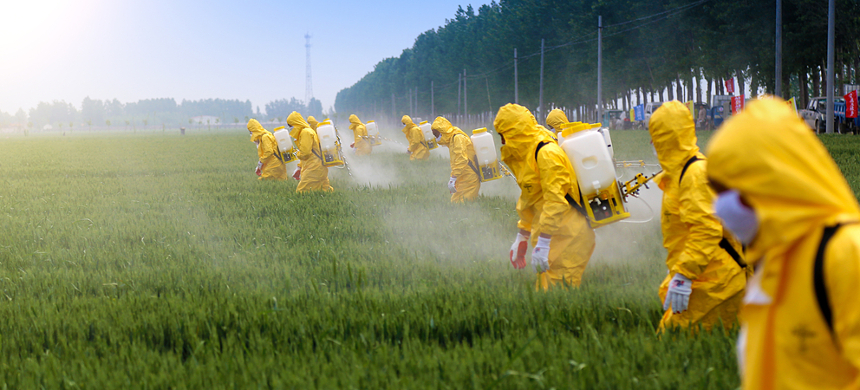 Applying pesticides to farm field. (photo: Getty)