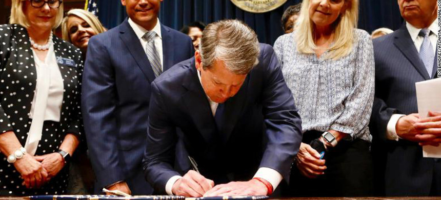 Georgia governor Brian Kemp on Tuesday signed a bill that would ban abortions if a fetal heartbeat can be detected. (photo: Bon Andres/AP)