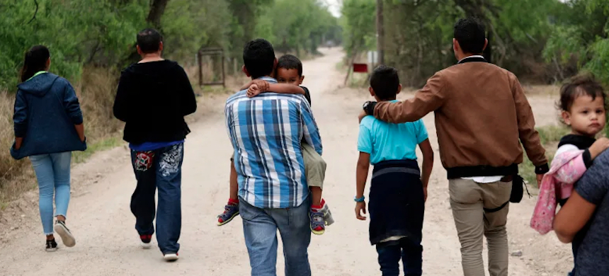 A group of migrant families walking from the Rio Grande river near McAllen, Texas. (photo: Eric Gay/AP)