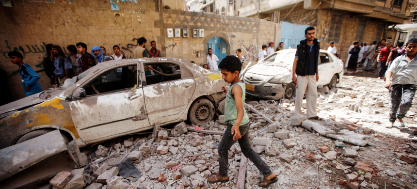 At least six civilians killed and dozens wounded as coalition jets strike residential areas in Yemen's capital. (photo: AFP)