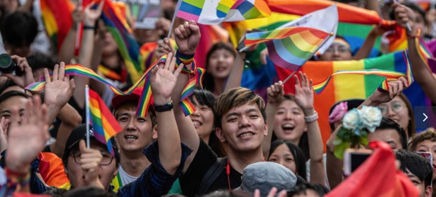 People celebrate after Taiwan's parliament voted to legalize same-sex marriage in Taipei, Taiwan. (photo: Carl Court/Getty)