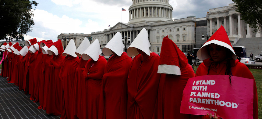 Women dressed as handmaids demonstrate outside the National Capitol in Washington, D.C. (photo: Aaron P. Bernstein/Reuters)