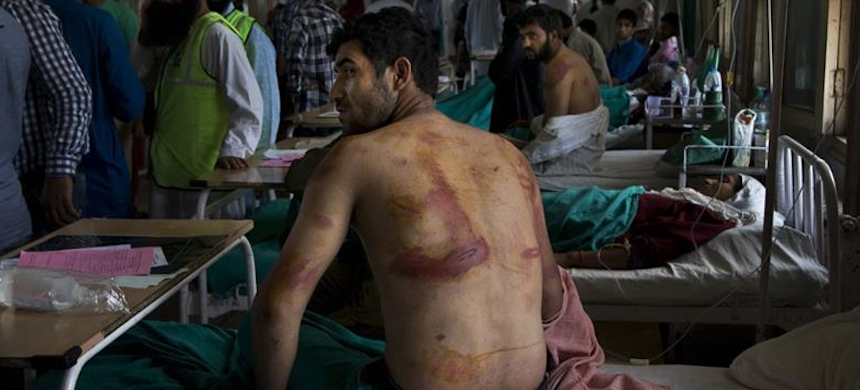 The report reveals that detainees were stripped naked, beaten with wooden sticks, iron rods or leather belts. (photo: Dar Yasin/AP)
