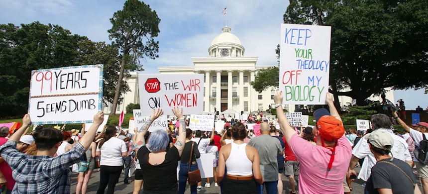 Protesters for women's rights hold a rally on the Alabama Capitol steps to protest a law passed last week making abortion a felony in nearly all cases with no exceptions for cases of rape or incest, Sunday, May 19, 2019, in Montgomery, Alabama. The American Civil Liberties Union and Planned Parenthood filed the lawsuit to overturn the near total Alabama abortion ban. (photo: Butch Dill/AP)
