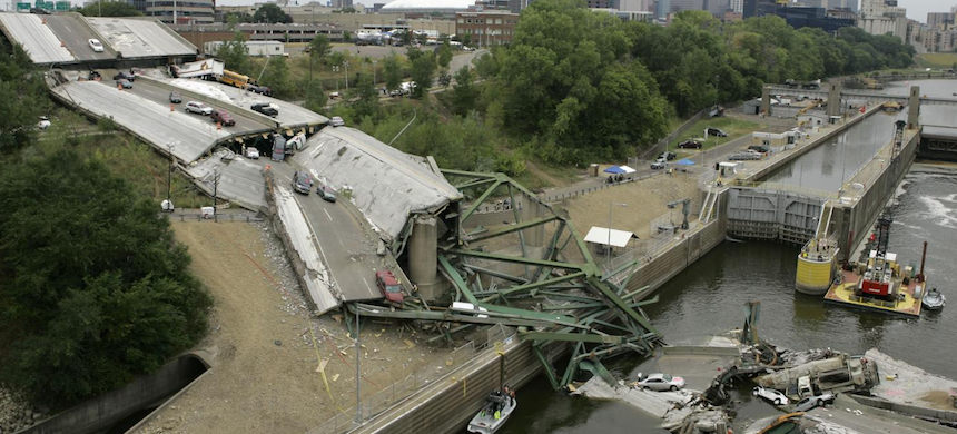 Vehicles are strewn among the wreckage of Interstate 35W bridge, which collapsed over the Mississippi River in Minneapolis. (photo: M. Spencer Green/AP)