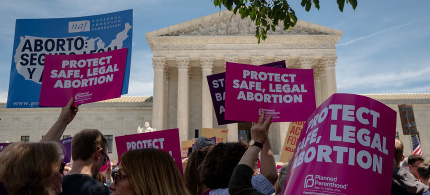 Protesters rallying in front of the Supreme Court earlier this month against state laws that aim to limit abortion. (photo: Hilary Swift/The New York Times)