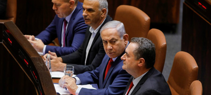Israeli prime minister Benjamin Netanyahu (C) sits before a vote on a bill to dissolve the Knesset (Israeli parliament) on May 29, 2019, at the Knesset in Jerusalem. (photo: AFP)
