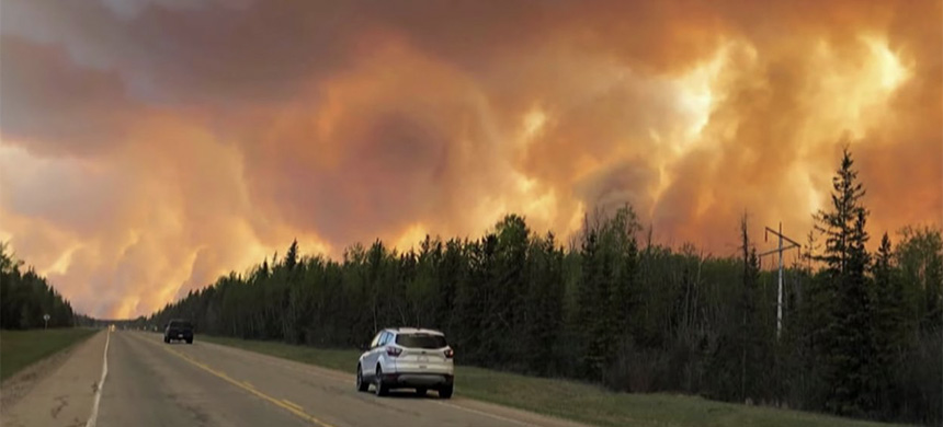 Thousands of Albertans have evacuated their homes due to out-of-control wildfires. (photo: CBC News/YouTube)