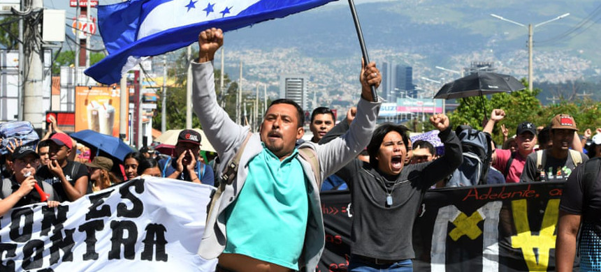 Demonstrators march against government reforms in Tegucigalpa on Tuesday. (photo: Orlando Sierra/Getty)