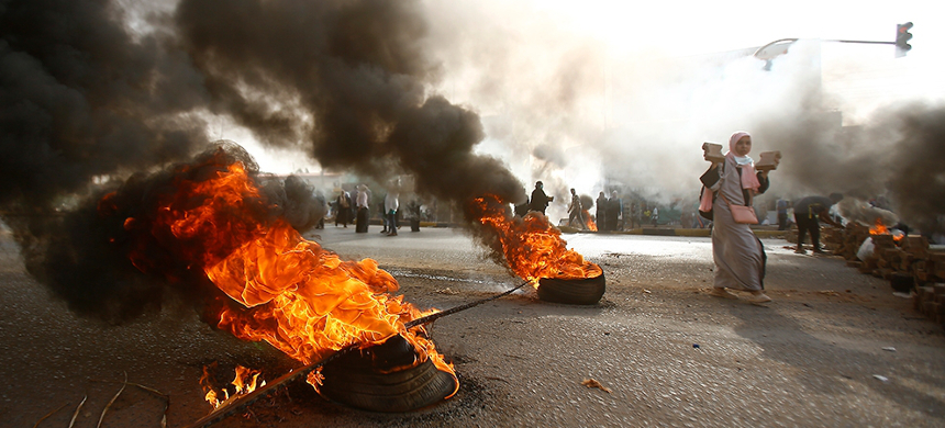Protesters burn tires as part of a protest. (photo: AFP)