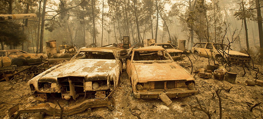Vintage cars line a property after the Loma fire burned through Loma Chiquita Road near Morgan Hill, California, on Sept. 28, 2016. (photo: Noah Berger/AP)