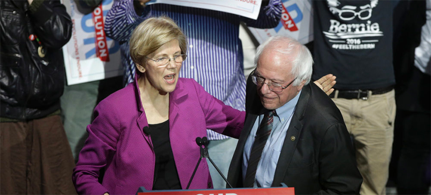Massachusetts senator Elizabeth Warren greets Vermont senator Bernie Sanders at a 2017 Our Revolution rally in Boston. (photo: Steven Senne/AP)