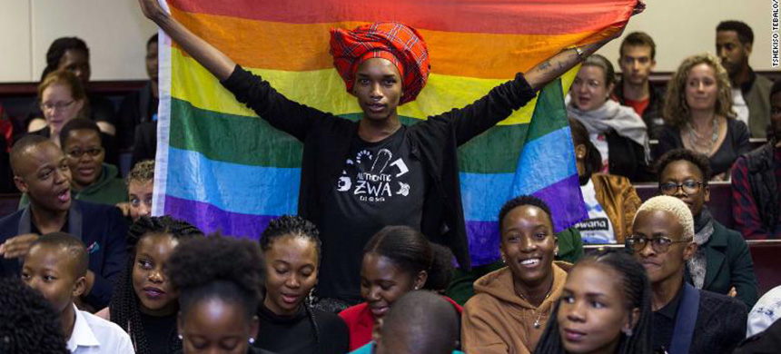 Activist Kat Kai Kol-Kes holds a LGBTQ pride flag inside Botswana's High Court on Tuesday, where lawmakers overturned a law that criminalized same-sex relations. (photo: Getty Images)