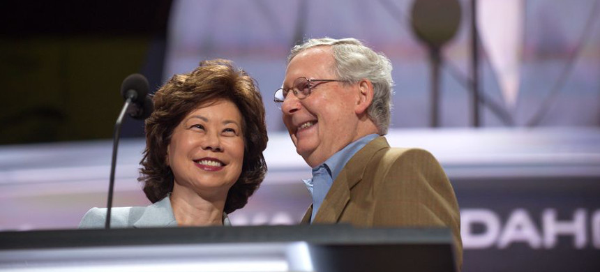 Mitch McConnell and his wife, Elaine Chao. (photo: Jeff Swensen/Getty)