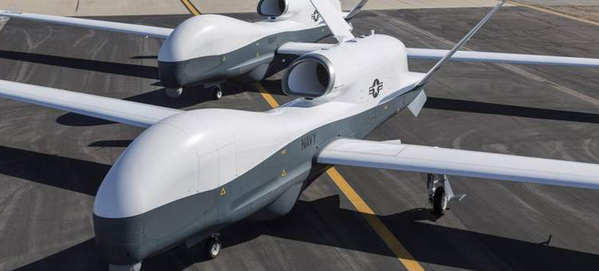 Two Northrop Grumman MQ-4C Triton unmanned aerial vehicles are seen on the tarmac at a Northrop Grumman test facility in Palmdale, California, May 22, 2013, in this handout photo provided by the U.S. Navy. (photo: Reuters)