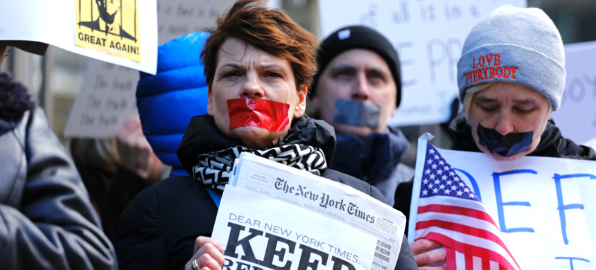 People take part in a protest outside The New York Times, February 26, 2017. (photo: Kena Betancur/Getty)