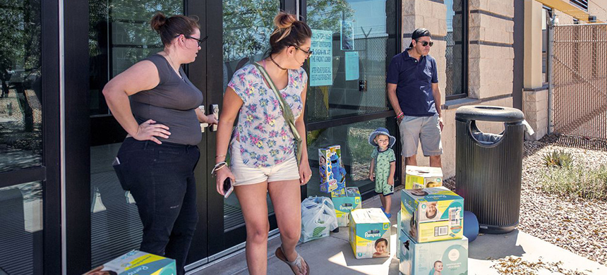 From left: Meagan O'Toole-Pitts, Ashley Cortez, Oliver Cortez, and his father, Mark Cortez, attempt to drop off diapers and toys for detained children at the immigration detention center in Clint. (photo: Armando Martinez/Texas Tribune)