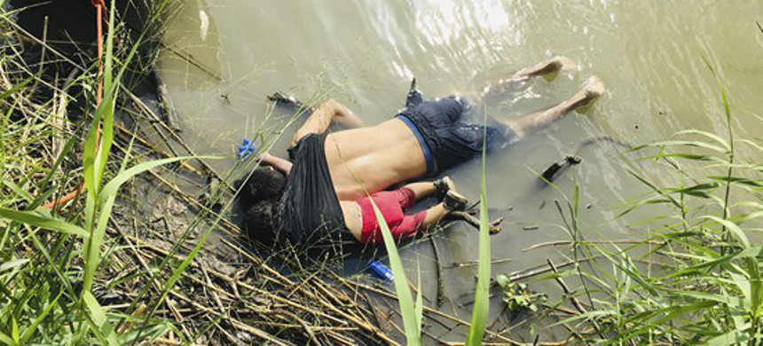 The bodies of Salvadoran migrant Oscar Alberto Martinez Ramirez and his nearly 2-year-old daughter Valeria lie on the bank of the Rio Grande in Matamoros, Mexico, June 24, 2019. (photo: Julia Le Duc/AP)