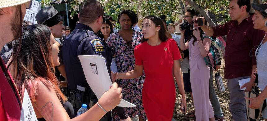 Rep. Alexandria Ocasio-Cortez of New York and Rep. Ayanna Pressley of Massachusetts took part in a Congressional fact-finding mission at migrant detention centers in Texas. (photo: Luke Montavon/Getty Images)
