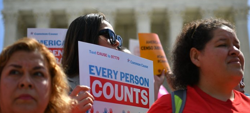 Demonstrators rally outside the U.S. Supreme Court in April to protest against the Trump administration's efforts to add a citizenship question to the 2020 census. (photo: Mandel Ngan/Getty Images)