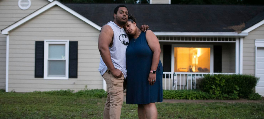 Carl Dunlap and Sommer Johnson in May at the home they rent in Douglasville, Ga. (photo: Elijah Nouvelage/The Washington Post)