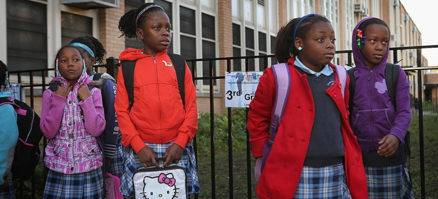 Students at a magnet school in Chicago wait for the start of classes last year. (photo: Scott Olson/Getty)