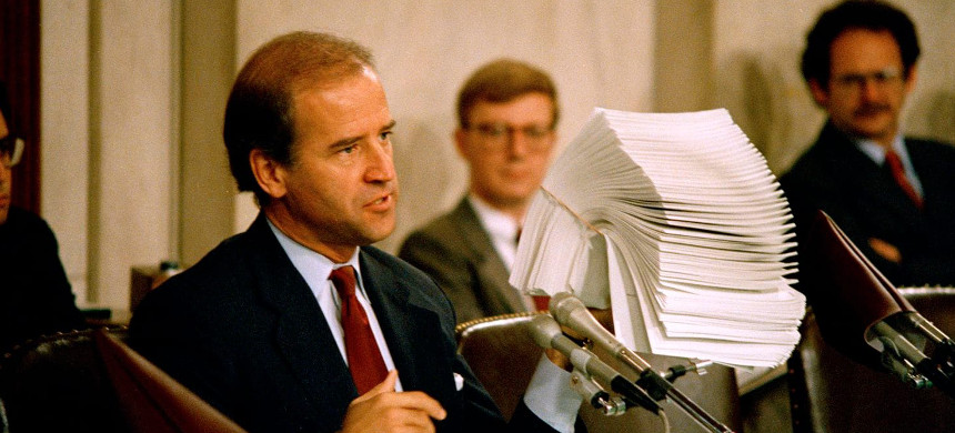 Sen. Joe Biden (D-Del.), then chairman of the Senate Judiciary Committee, holds up letters from law professors opposing the confirmation of Judge Robert Bork to the Supreme Court on Capitol Hill on Sept. 30, 1987. (photo: John Duricka/AP)