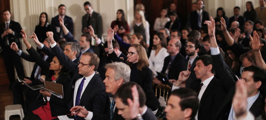 Reporters shout questions during a news conference by U.S. president Donald Trump at the White House. (photo: Carlos Barria/Reuters)