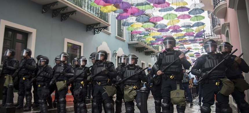 Police block protesters from advancing to La Fortaleza governor's residence in San Juan on Sunday. (photo: Carlos Giusti/AP)