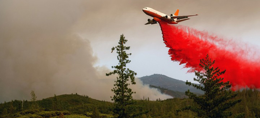 Since the early 1970s, summertime forest fires - such as the Ferguson Fire last year - have gotten 800 percent larger. (photo: Noah Berger/Getty Images)