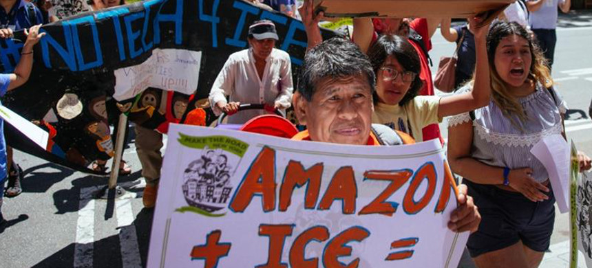 The protest march to CEO Jeff Bezos's condo building in New York City aimed to raise awareness of how Amazon is facilitating surveillance efforts and coincided with Prime Day discounts. (photo: AFP)