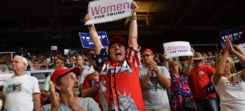 People cheer as Donald Trump speaks at a rally. (photo: AFP)