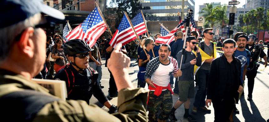 Trump supporters and anti-Trump protesters in downtown L.A. during a November 2017 rally. (photo: Wally Skalij/LA Times)