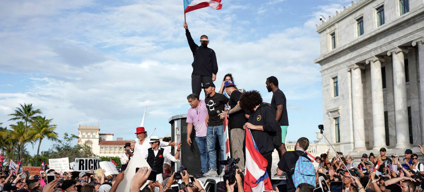 Puerto Rican singer Ricky Martin (C), Puerto Rican rapper Rene Perez, aka Residente (R), Puerto Rican reggaeton singer Bad Bunny (top), take part of a demonstration demanding Governor Ricardo Rossello's resignation in San Juan, Puerto Rico, July 17, 2019. (photo: Eric Rojas/Getty)