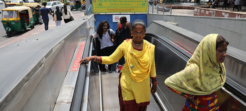 Indian women walk out of the Delhi Metro last month. (photo: Rajat Gupta/EPA-EFE/Shutterstock)