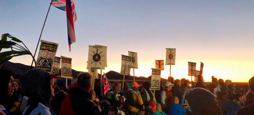 Demonstrators gather to block a road at the base of Hawaii's tallest mountain, Monday, July 15, 2019, in Mauna Kea, Hawaii. (photo: CNN)