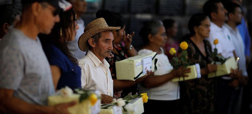 Relatives participate in a ceremony to commemorate the 37th anniversary of El Mozote Massacre in the village of El Mozote, Meanguera, El Salvado. (photo: Jose Cabezas/Reuters)