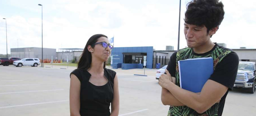 U.S. citizen Francisco Galicia, 18, chats with his attorney, Claudia Galan, after his release from the South Texas Detention Facility in Pearsall, Texas. (photo: Kin Man Hui/LMT)