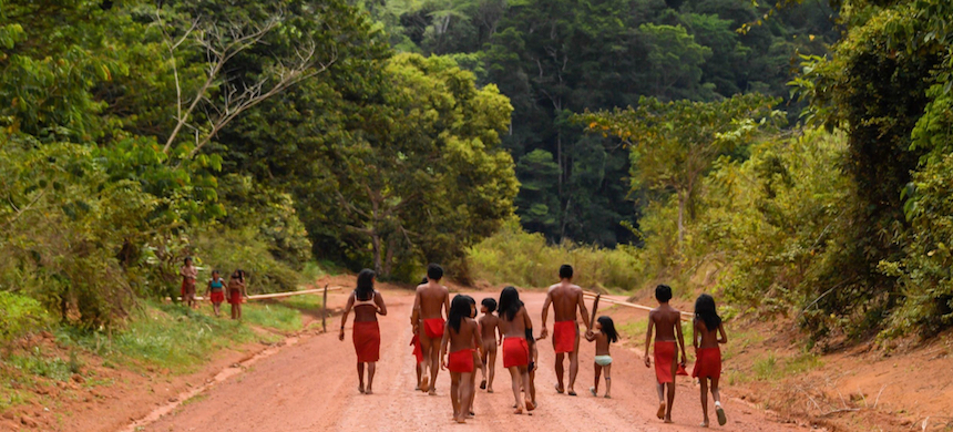 Brazilian Waiapi walk through an indigenous reserve in Amapa state in 2017. Brazil's tribal peoples have long faced pressure from miners, ranchers and loggers. (photo: AFP)