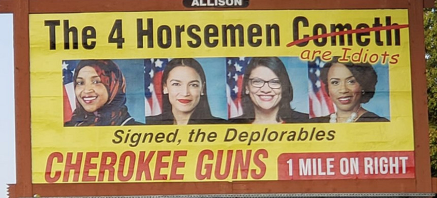 Cherokee Guns in Murphy, North Carolina, has a sign inciting violence against four minority members of congress. (photo: Getty)