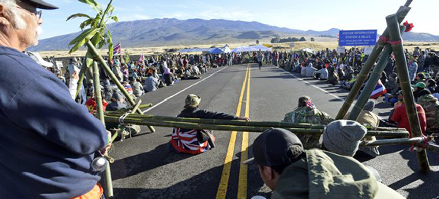 In this July 19, 2019 photo, protesters continue their opposition vigil against the construction of the Thirty Meter Telescope at Mauna Kea on the Big Island of Hawaii Friday. (photo: Bruce Asato/AP)
