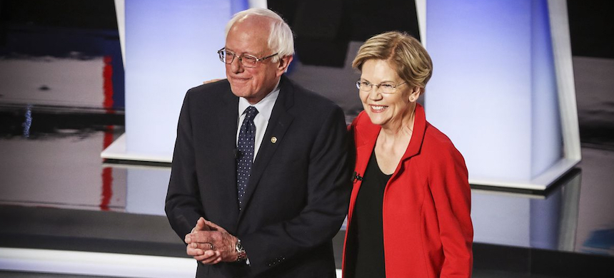 Democratic presidential candidates Sens. Bernie Sanders (I-VT) and Elizabeth Warren (D-MA) take the stage during the first night of the second Democratic presidential debate on July 30, 2019. (photo: Justin Sullivan/Getty Images)