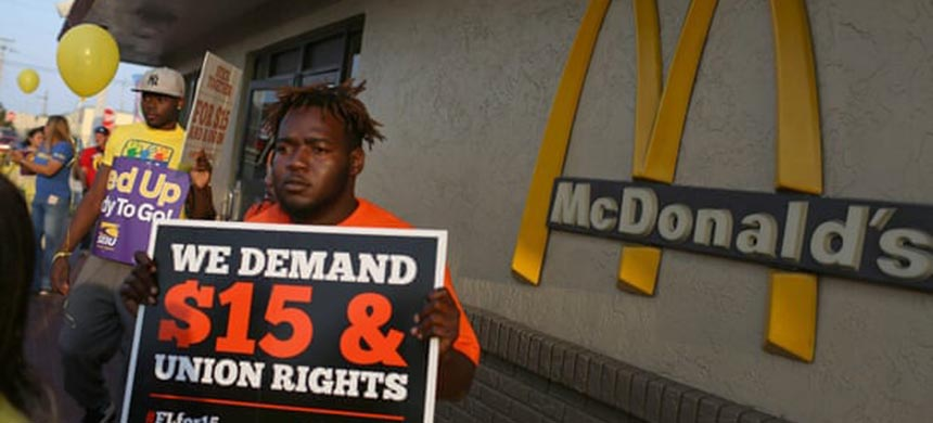 People gather at a McDonald's restaurant in Miami to demand a minimum wage increase to $15 an hour. (photo: Joe Raedle/Getty Images)