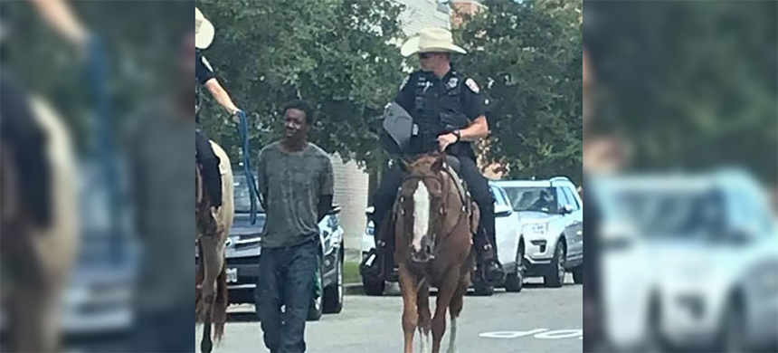 Galveston, TX, police officers identified Brosch and Smith arresting Donald Neely, who they escorted to the police station with a rope and handcuffs while both officers were riding horseback. (photo: shaunking/Twitter)