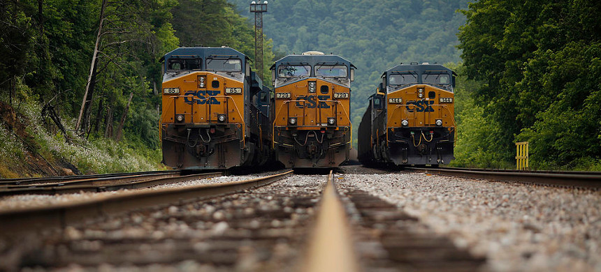 Coal trains sit in a rail yard in 2014 in Pikeville, Kentucky. (photo: Luke Sharrett/Getty)