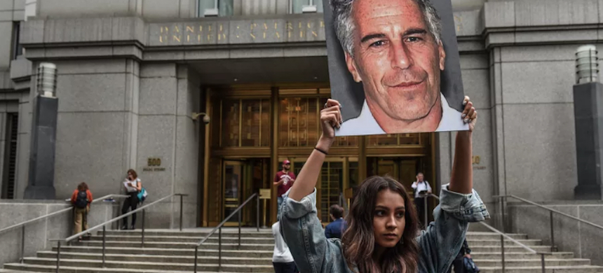 A member of a protest group demonstrates against Jeffrey Epstein in New York. (photo: Stephanie Keith/Getty Images)
